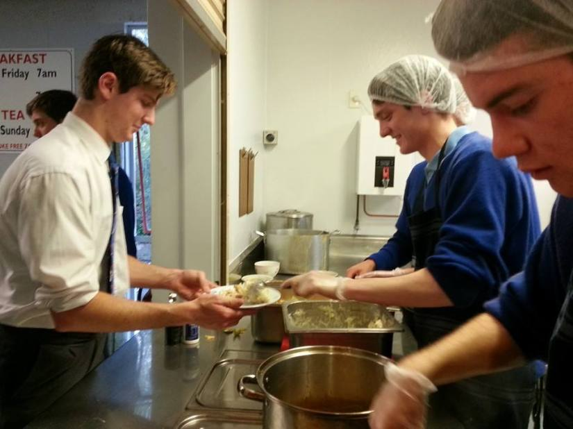Rosmini College Students sharing a meal with residents in a local Emergency Housing Centre