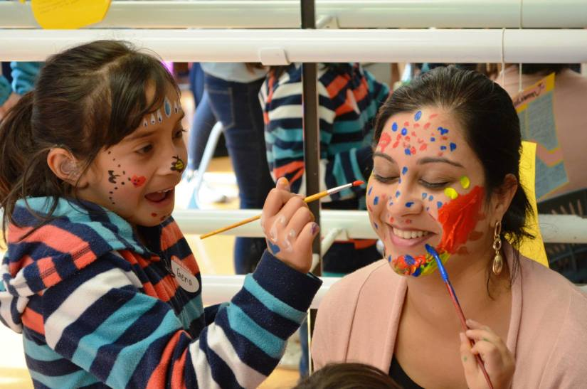 Marist staff member Karen Pinto getting her face painted by the kids