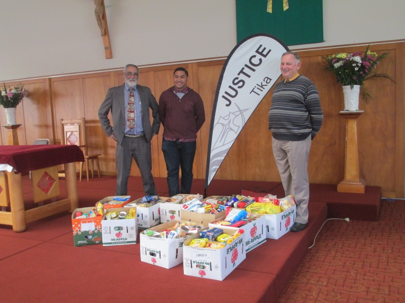 (Right) Principal of St Annes School with (Left) Vinnies youth team Peter and Pelasio with the food collection.