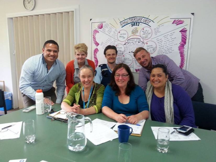 Sam pictured with members of the Ranui Caravan Park steering committee.