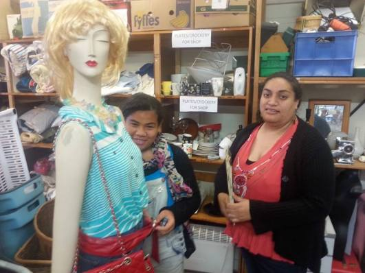 Tala and Niagaai posing with 'Manny', at the Kingsland Vinnies Centre