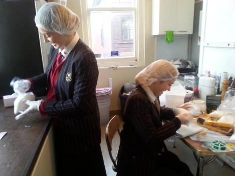 Baradene College students pack bags of sugar to be added into family food parcels.