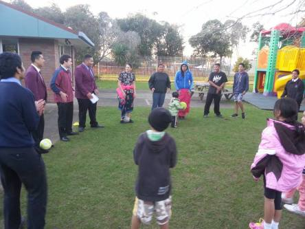 De La Salle College students lead the children in an outdoor activity