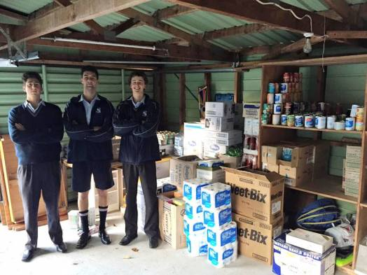 Sacred Heart College Vinnies dropping off proceeds from a food drive to a local foodbank