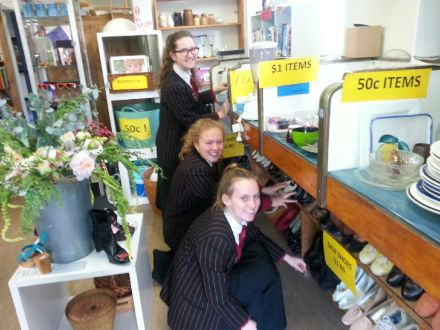 Baradene College students pack items for sale in the opshop