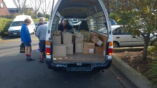 Rosmini College students pack much needed food and clothing for distribution across the community