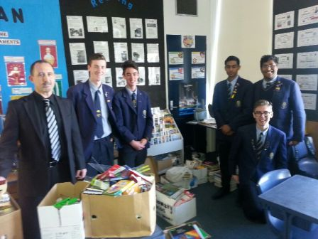 St Peter's College with proceeds of their Stationary Drive