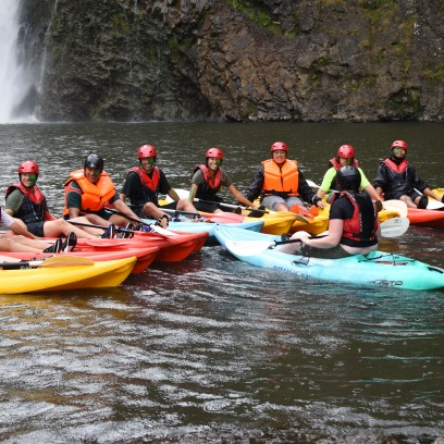 Leaders learning how to kayak in sync