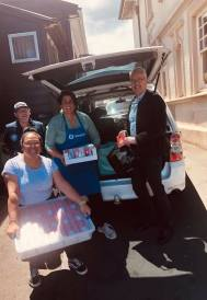 (Pictured) Geoff, Savi, Del and Richard Ward: Mt Eden Prison Chaplain picking up the Christmas Cards